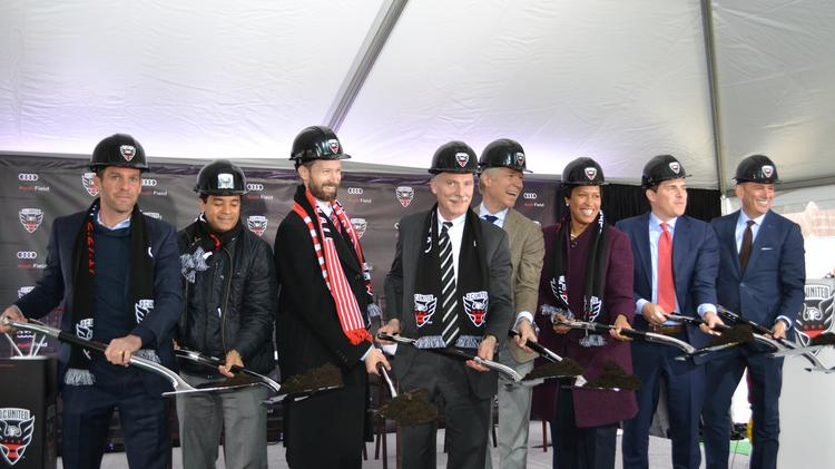 Officials from the District government, Audi North America and Major League Soccer join D.C. Mayor Muriel Bowser, third from right, at a groundbreaking for Audi Field.
