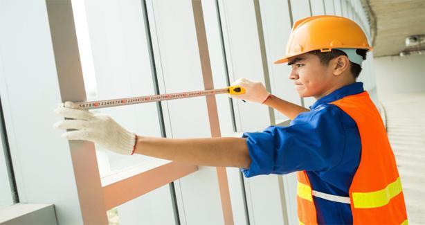 Contruction worker measuring window