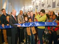 Mayor Muriel Bowser - with government, library, business and community leaders and artists, cut the ribbon to open the West End Library. Photo by Patrick G. Ryan