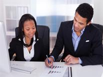 Woman and man reviewing document on desk
