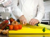 Chef at cutting board
